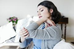 elbow pain in a woman - stock photo
