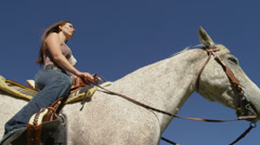 Woman Sitting on Gray Horse, Shot From Below Stock Footage