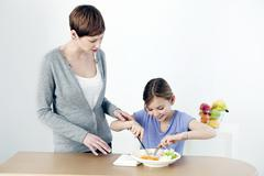 Child eating a meal Stock Photos