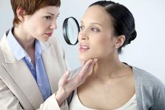 Dermatology consultation, pregnant woman Stock Photos
