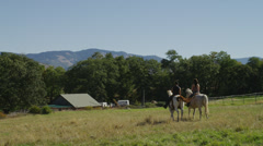 Guy & Girl on Horses Stock Footage