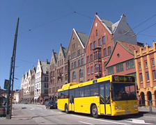 Street view Bryggen, facades trade houses and public transport Stock Footage