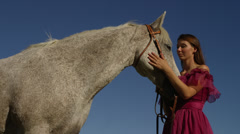 Woman Hugging Horse's Face Stock Footage