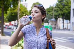 Thirsty woman Stock Photos