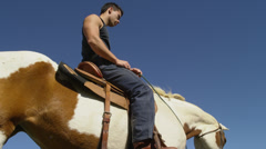 Man Sitting on Brown and White Horse, Low Angle Stock Footage