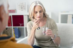 Senior taking medication Stock Photos