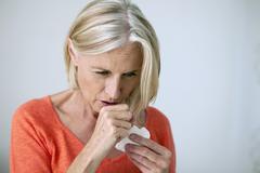 senior sneezing - stock photo