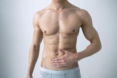 abdominal pain in a man - stock photo
