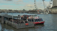 London - Thames, cruise boat passengers near the Eye Stock Footage