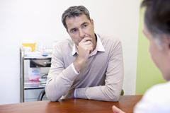 Man in consultation, dialogue Stock Photos