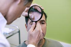 Stock Photo of dermatology consultation man