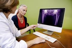 rheumatology consultation senior - stock photo
