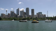 Stock Video Footage of Sail boats and small water taxi in front of Sydney skyline
