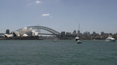 Sydney Opera house with Harbour bridge with boats in front of it Stock Footage