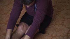 Man doing exercises to stretch the hamstring Stock Footage