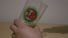 Tipping beer a beer (badly) for an 18th birthday Stock Footage