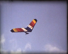SUPER8 hang glider flying and landing - stock footage