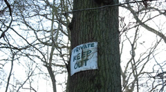 Private Keep Out sign on tree Stock Footage