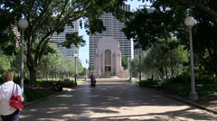 People walking in Hyde park to the ANZAC war memorial Stock Footage