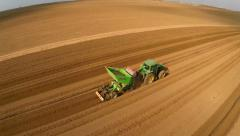 Tractor harvesting the field - stock footage