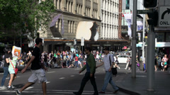 Busy crossing with people walking downtown Sydney Stock Footage