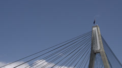Top of the The ANZAC Bridge in Sydney with the Australian flag - stock footage