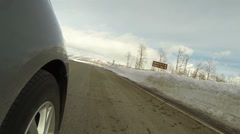 Driving car winter mountain road POV wheel 4 HD 0288 Stock Footage