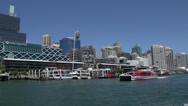Stock Video Footage of Red ferry leaving Darling Harbour filmed from a ferry