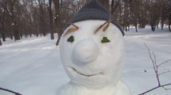 Funny Snowman in Forest in Winter, Christmas Time Celebration in Park Stock Footage