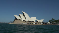 Pan from ferry passing by the Opera House in Sydney Stock Footage