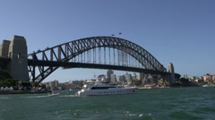 Big private yacht passing by the Sydney harbour bridge Stock Footage