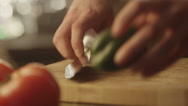 Stock Video Footage of Professional Chef is Rapidly Chopping Green Ball Pepper in Kitchen