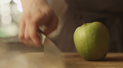 Professional Chef is Rapidly Chopping Green Apple in Kitchen - stock footage