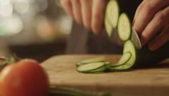 Professional Chef is Rapidly Chopping Cucumbers - stock footage
