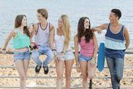Stock Photo of group of diverse teens at beach