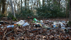 Rubbish scattered in a nature reserve - dolly Stock Footage