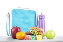 school lunch with alphabet blocks - stock photo
