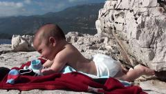 Baby sunbathing on rock 2 Stock Footage