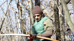 Closeup longbow, man shooting in the forest Stock Footage