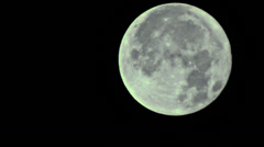 Full Moon descending Stock Footage
