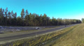 route,  highway in wood and  sunny day. Aerial HD Footage