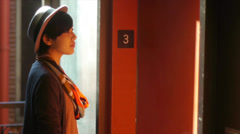 Pretty Young Woman With Hat & Scarf Waiting For An Elevator Stock Footage