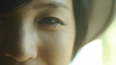 Moving Close Up Of A Sweet Young Asian Woman Wearing A Hat - stock footage
