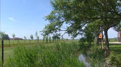 Dutch Polder pan black tarred barn called Zeeuwse Schuur Stock Footage