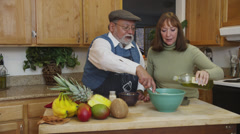 Retired Couple Making Pasta in Kitchen Stock Footage