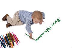 Baby draws with crayons bonne fetes maman Stock Photos