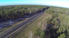 Beautiful flight over  wood and  road with cars. Aerial - stock footage