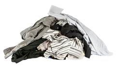 stacked used shirts isolate on white bcakground - stock photo