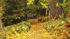 Young Guy Jogging Down Path in Park Stock Footage