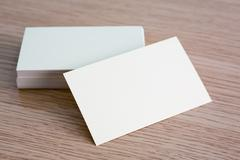 Business cards on wood table Stock Photos